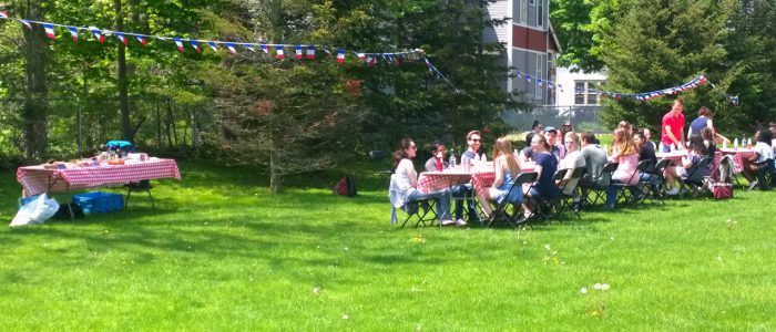Students enjoying a large picnic outdoors for Spring 2019 French Day.