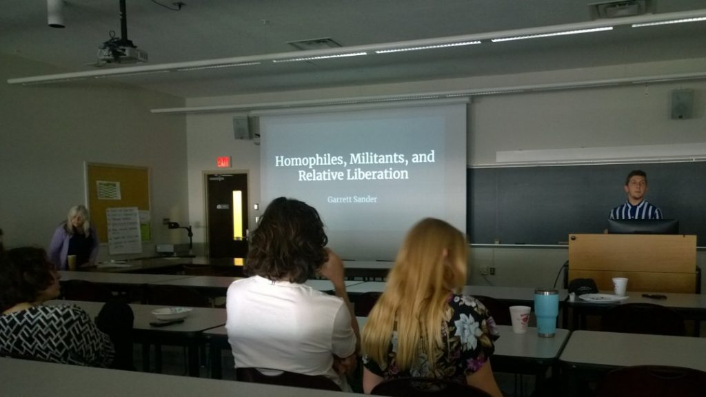 Garret Sander presenting on Homophiles, Militants, and Relative Liberation