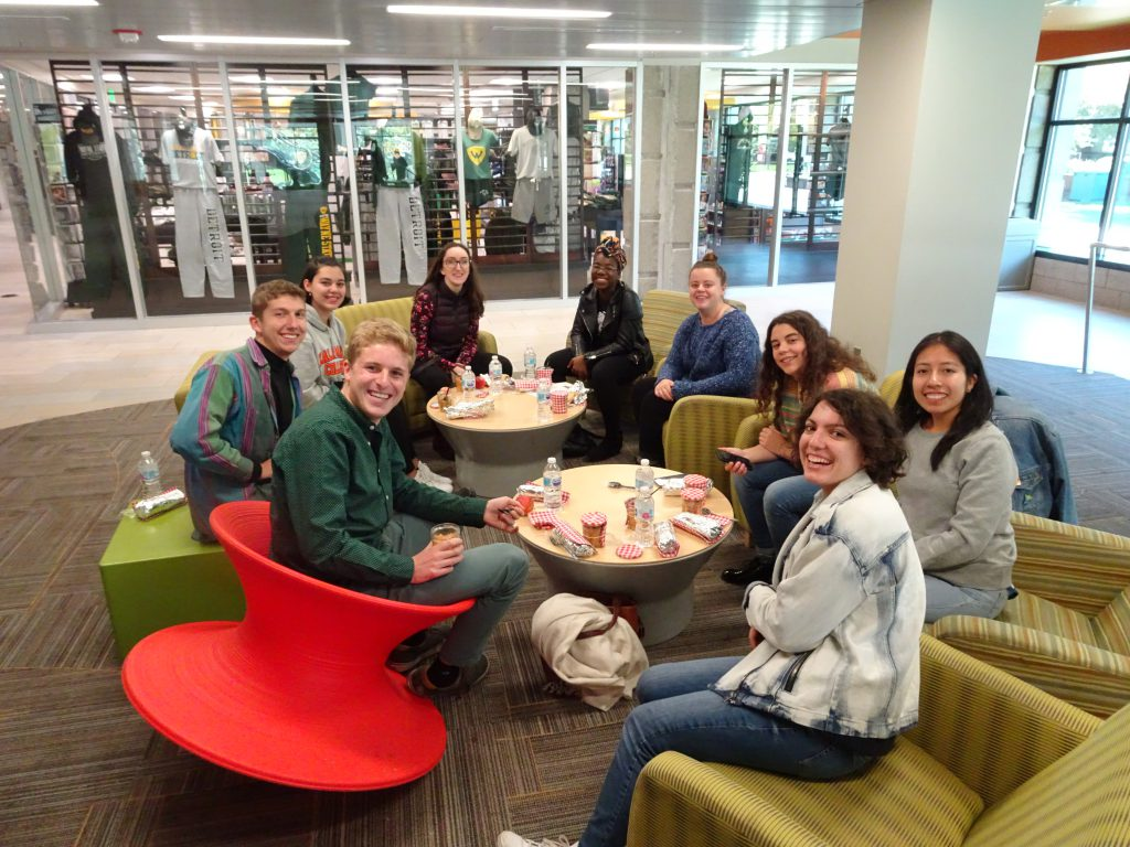 Group of 9 K College students having a picnic indoors at the First French Day in Detroit.